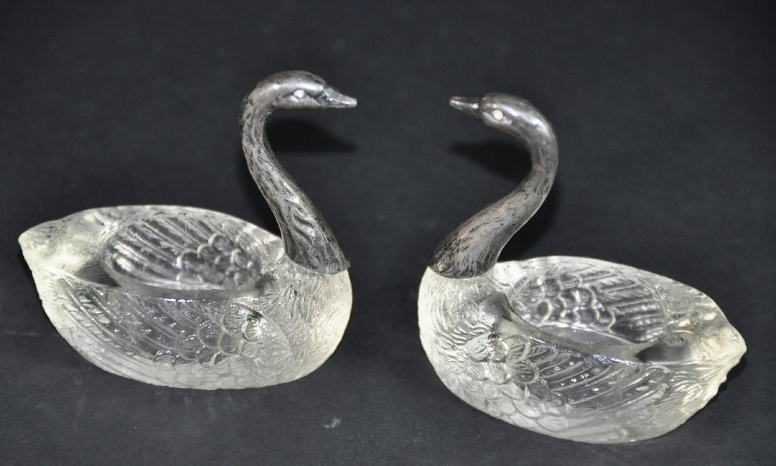 A pair of crystal and silver swans