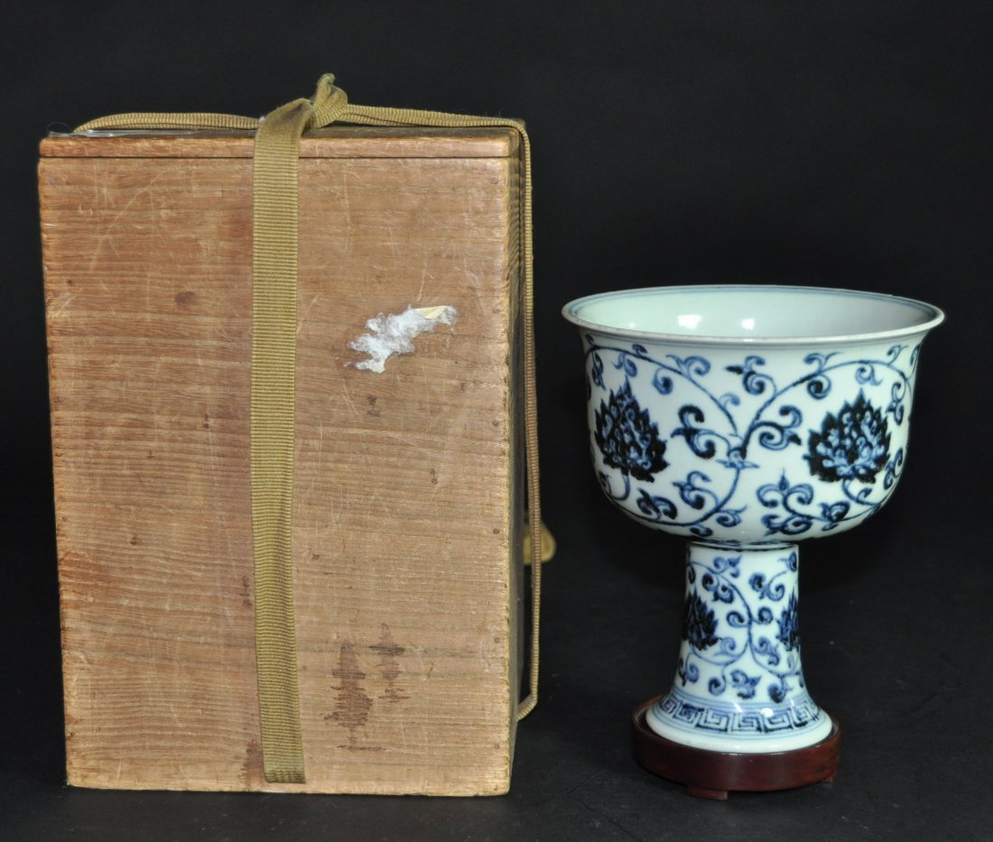 A Ming Dynasty blue and white high leg cup