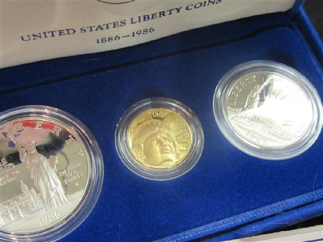 (2) 1986 U.S. Liberty 3- Coin Sets; each with $5 Gold - 2
