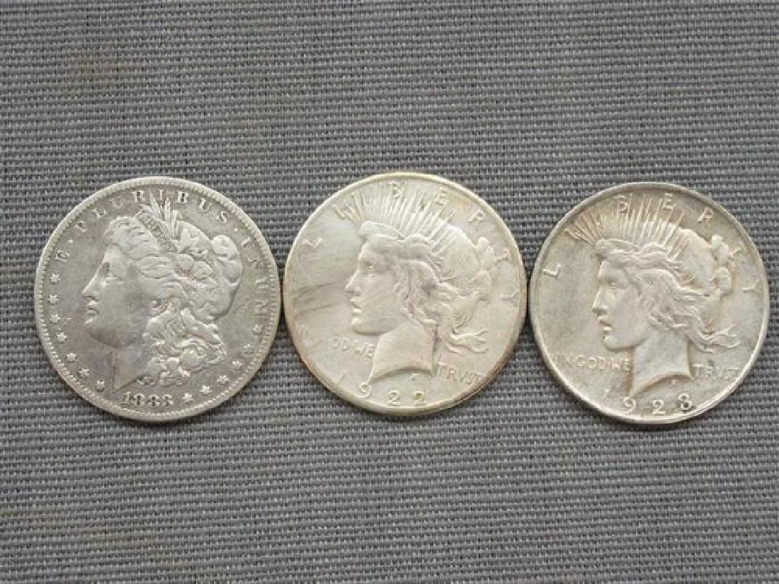Three (3) Morgan And Peace Silver Dollars