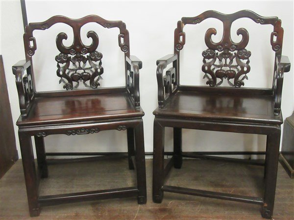 A Pair. Chinese Carved Rosewood Arm Chairs