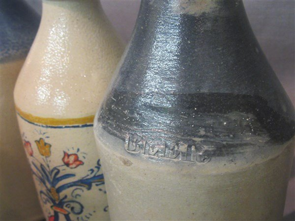 8 Stoneware Bottles - 6