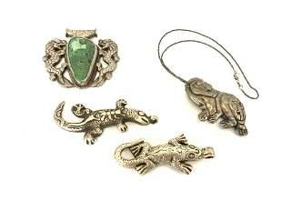 Four (4) Sterling Silver Tibetan Pendants