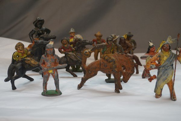 Fourteen (14) Cast Iron Cowboys and Indians
