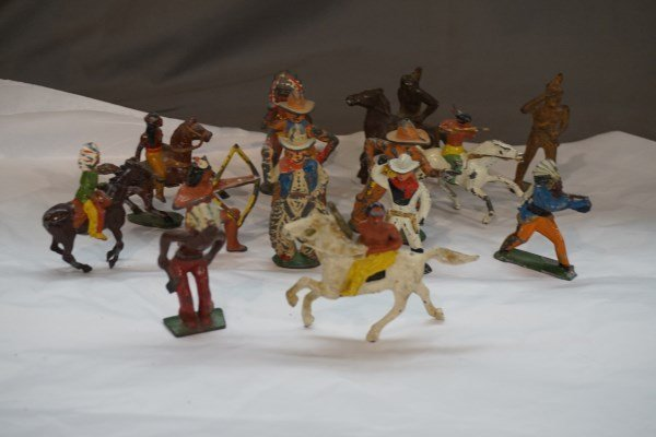 Fourteen (14) Cast Iron and Lead Cowboys and Indians