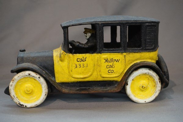 c. 1920 Yellow Taxi Cab Cast Iron Toy by Arcade