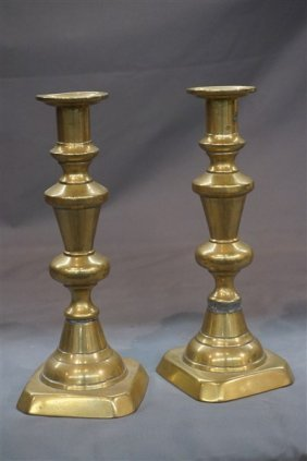 A Pair, 19th Century Brass Push Up Candlesticks