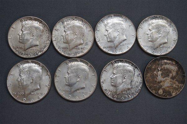 Eight (8) Kennedy Silver Half Dollars