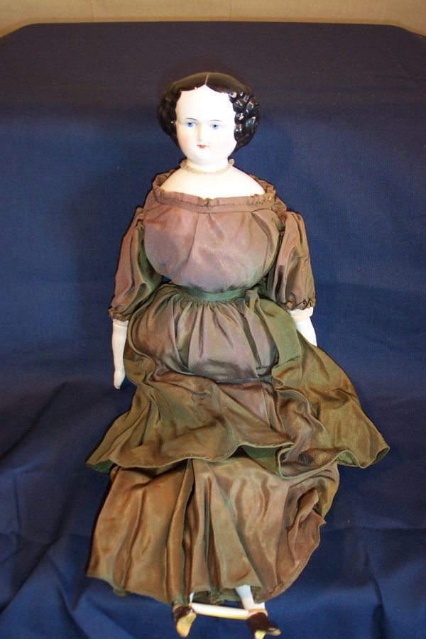 1: China head doll, cloth body, 19 inches long, china h