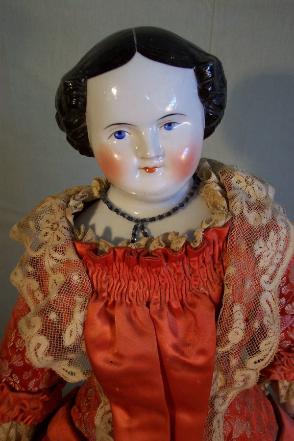 3: China head doll, cloth body, 22 inches long, china h