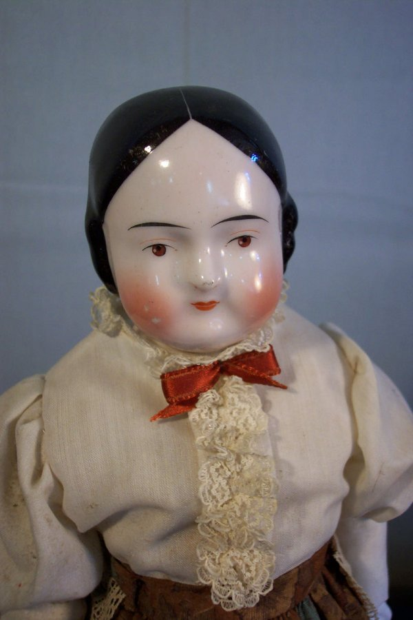 7: China head doll, cloth body, 15 inches long, non-mat