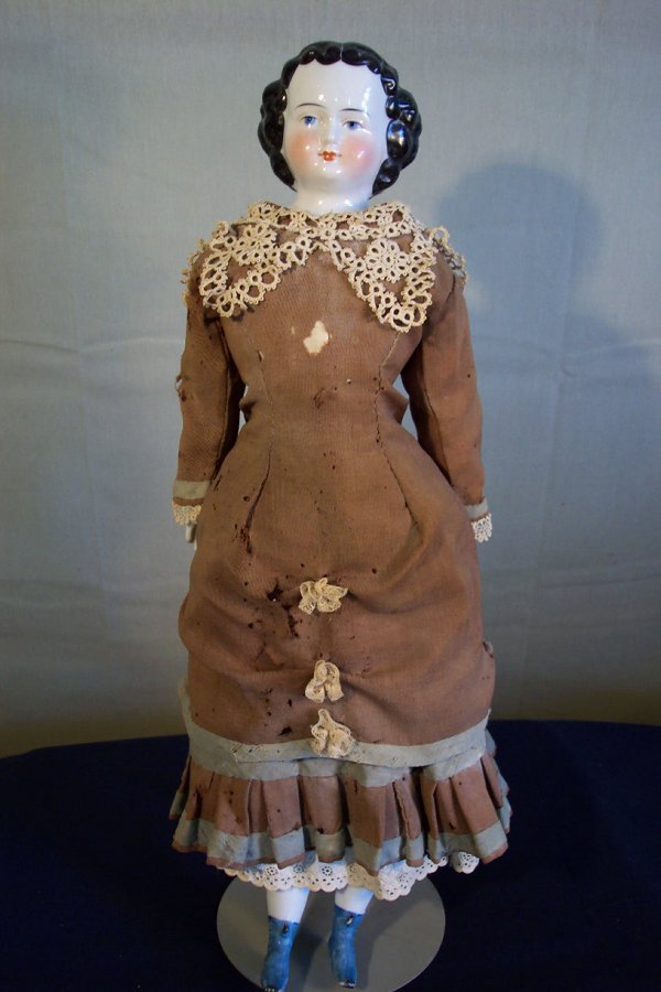 8: China head doll, 22 inches tall, china hands and fee
