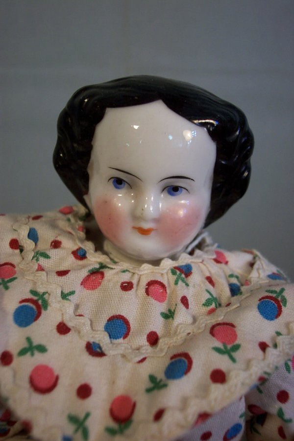 9: China head doll, 11 inches tall, china hands and fee