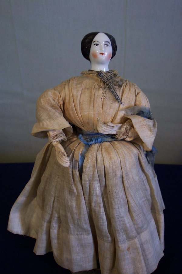 10: China head doll, early, 9 1/2 inches tall, cloth bo