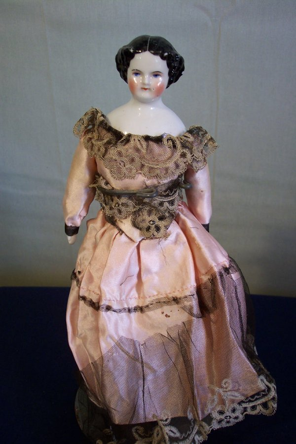 11: China head doll, 10 1/2 inches tall, cloth body, ch