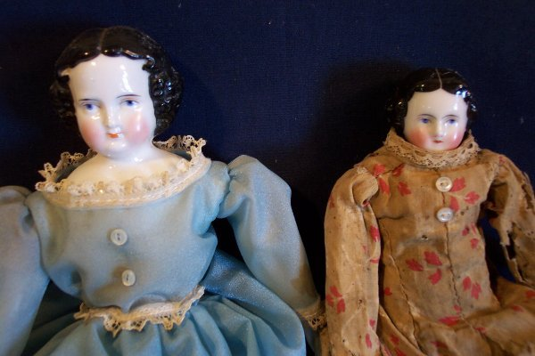 13: Two china head dolls, 11 1/2 and 10 inch, doll in b