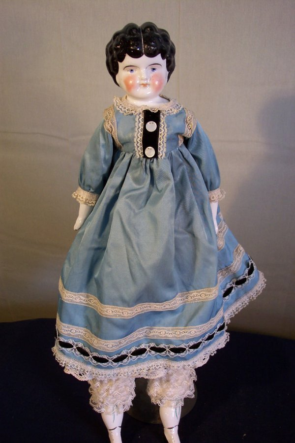 18: China head doll, 20 inch, china hands and feet, fin