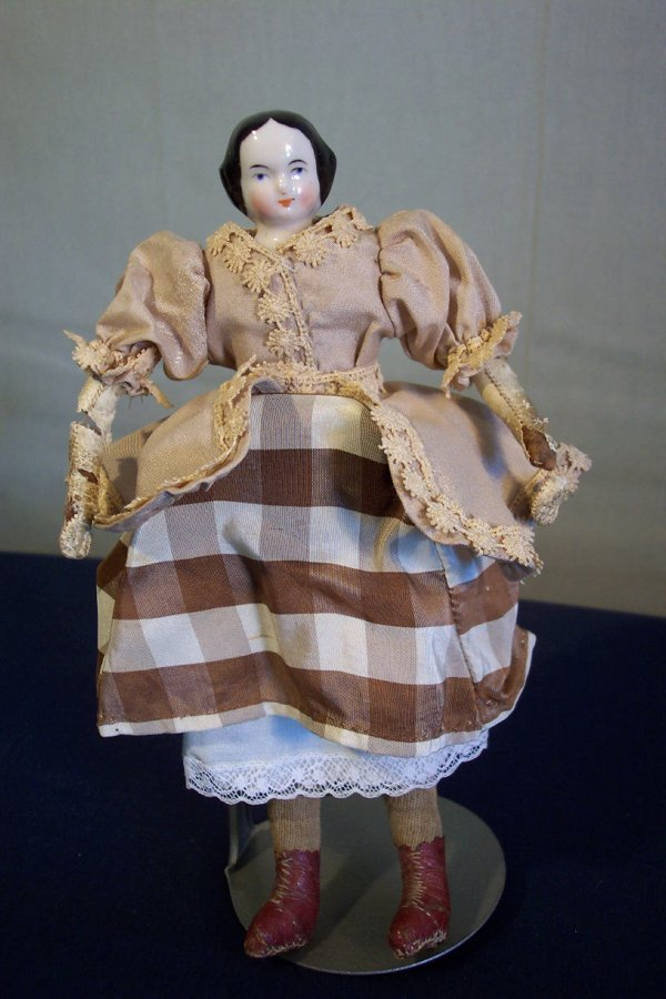 19: China head doll, 8 inch, cloth body, leather arms i