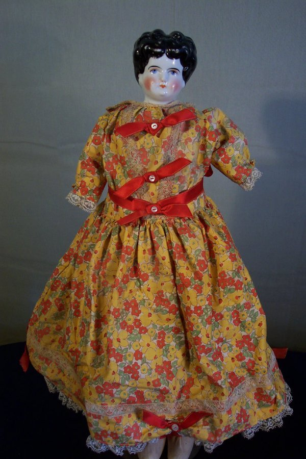 21: China head doll, 19 inch, leather torso, cloth hand