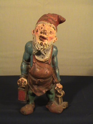 208: Cast iron door stop, Hubley style, gnome with keys