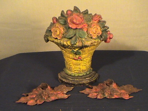 213: Lot of floral cast iron, basket bookend or doorsto