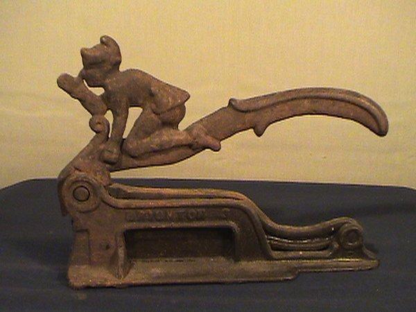 214: Brighton tobacco plug cutter, cast iron with elf r