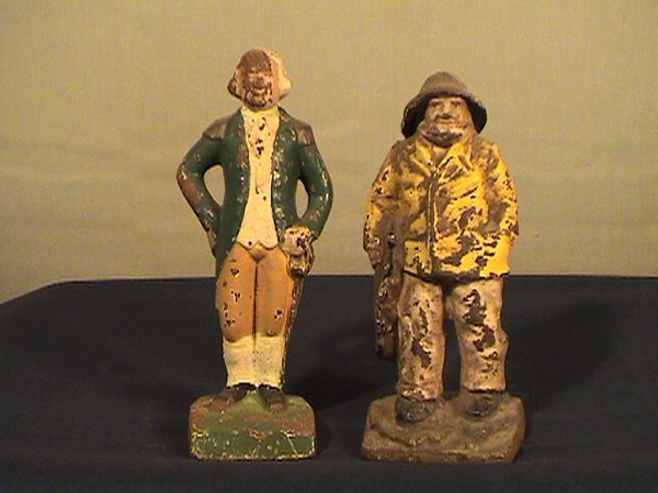215: Cast iron figurines, fisherman, George Washington