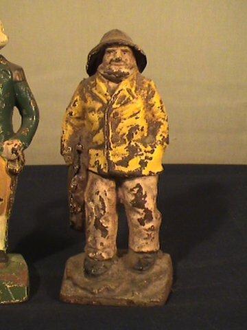 215: Cast iron figurines, fisherman, George Washington - 2