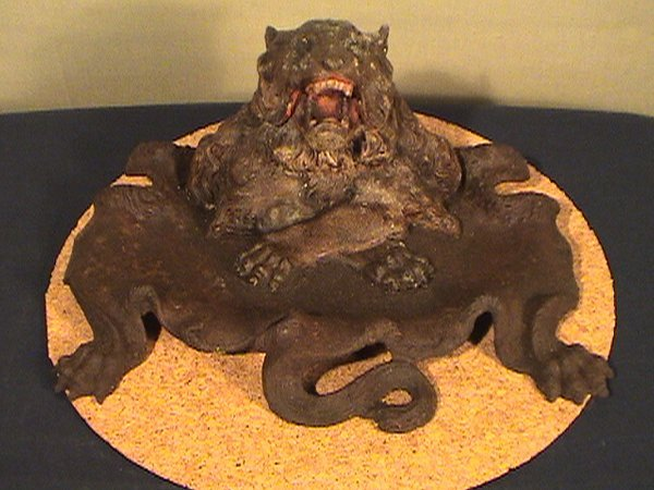 219: Cast iron lion inkwell, flip lid, 11 inches long a