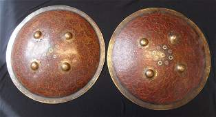 A PAIR OF INDIAN SHIELDS DHAL 20TH CENTURY of brass