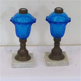 Pair of early blue oil lamps