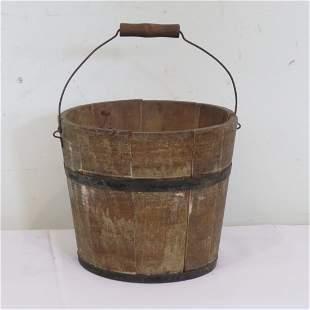 Wooden bucket in old mustard paint