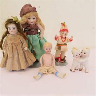 4 German bisque jointed dolls and one kewpie pair