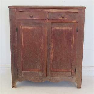 Cherry jelly cupboard in old worn red paint