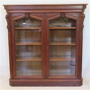 Ca. 1870 walnut glass door bookcase