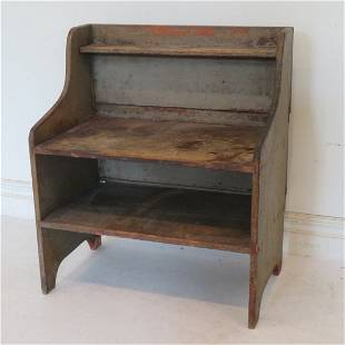 Early pine bucket bench in old gray paint over red
