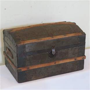 Metal covered doll trunk with wood strips