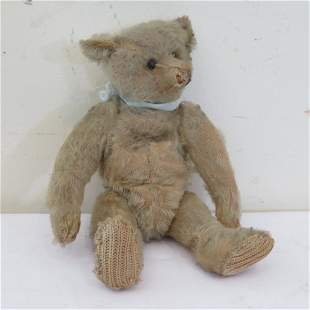 Early jointed teddy bear with shoe button eyes