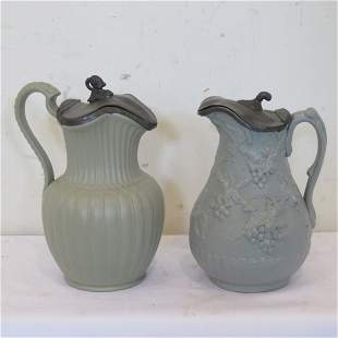 2 Staffordshire syrup jugs with pewter lids
