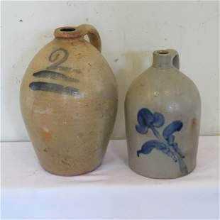 2 stoneware jugs with blue decoration