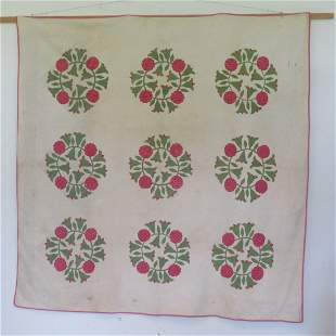 Early handstitched applique PA quilt with tulip design