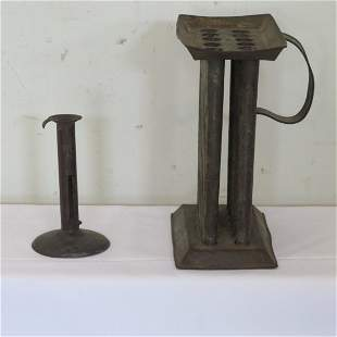 Early hogscraper candlestick & 12 hole tin candle mold