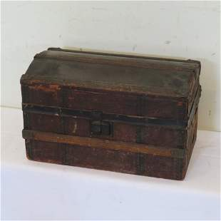 Wood doll trunk covered in lithograph paper
