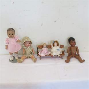 Group of 5 small dolls