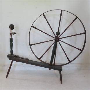 Walking spinning wheel in old green paint