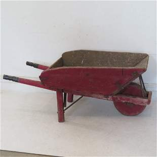 Old country wheel barrow in old red paint