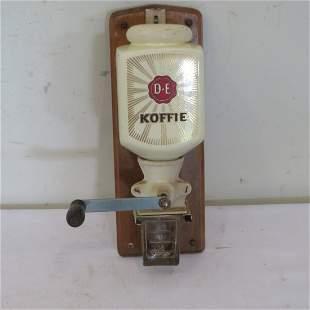 German hanging coffee grinder signed D.E. Koffie