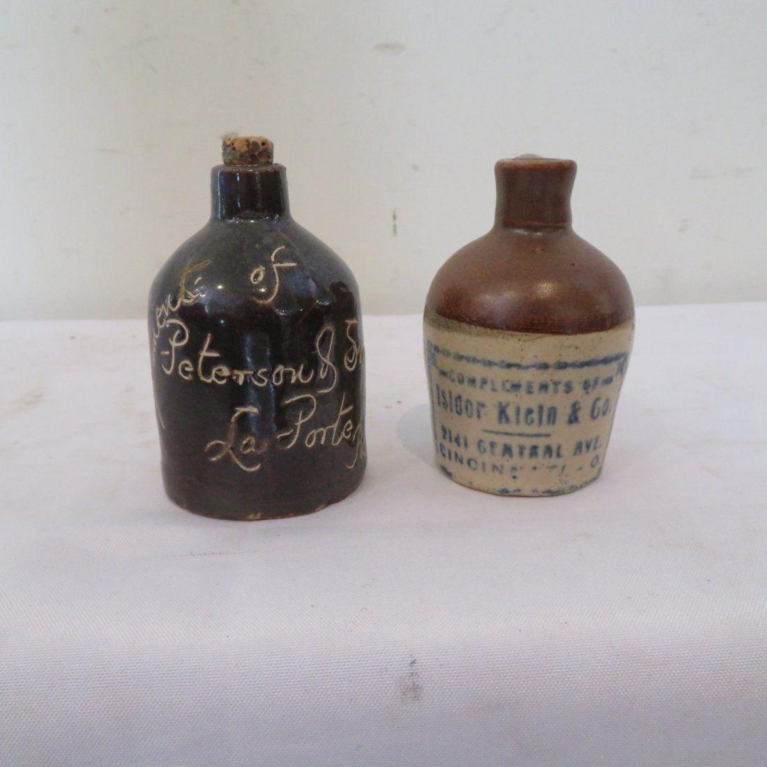 2 miniature stoneware advertising jugs