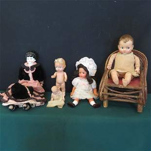 5 old dolls and twig doll chair