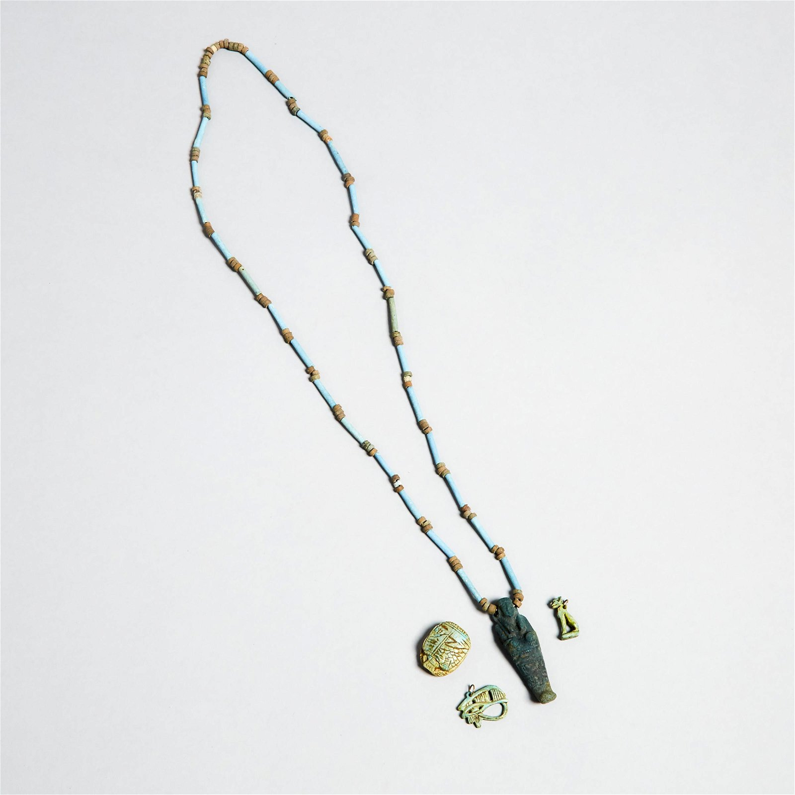 Group of Egyptian Turquoise Faience Amulets and Beads,